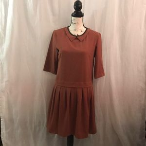 M dress with faux leather trim around the collar